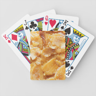 Macro of almond splitters on a cake bicycle playing cards