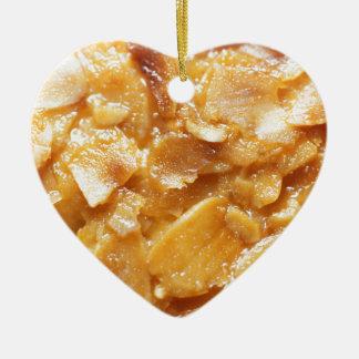 Macro of almond splitters on a cake ceramic heart ornament