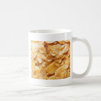 Macro of almond splitters on a cake coffee mug