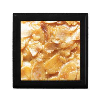 Macro of almond splitters on a cake gift box