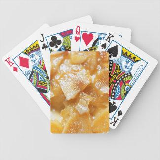 Macro of almond splitters on a cake poker deck