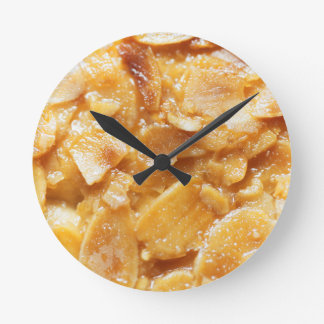 Macro of almond splitters on a cake round clock