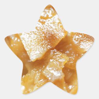 Macro of almond splitters on a cake star sticker