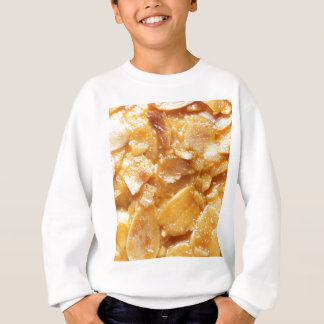 Macro of almond splitters on a cake sweatshirt