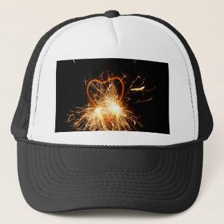 Macro photo d'un cierge magique brûlant sous la casquette