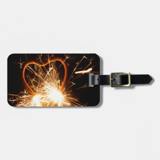 Macro photo of a burning sparkler in form of a hea luggage tag
