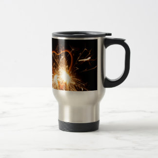 Macro photo of a burning sparkler in form of a hea travel mug