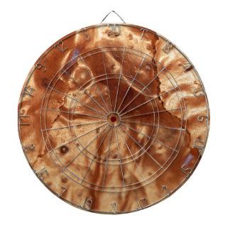Macro photo of a chocolate cover of a cake. dartboard