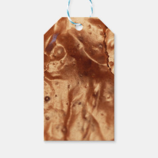 Macro photo of a chocolate cover of a cake. pack of gift tags