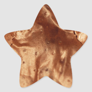 Macro photo of a chocolate cover of a cake. star sticker