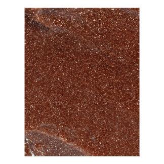 Macro photo of Goldstone glass Letterhead