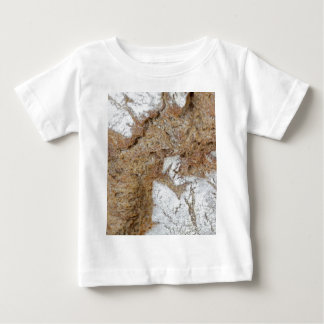 Macro photo of the surface of brown bread baby T-Shirt