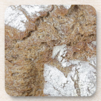 Macro photo of the surface of brown bread coaster