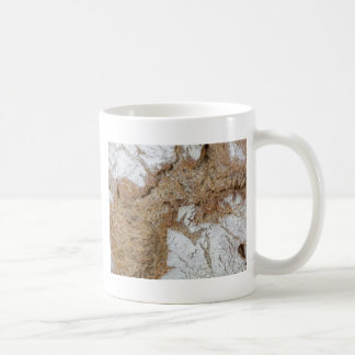 Macro photo of the surface of brown bread coffee mug