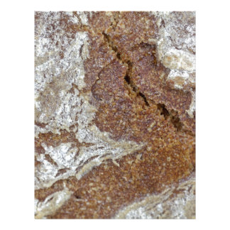 Macro photo of the surface of brown bread from Ger Letterhead