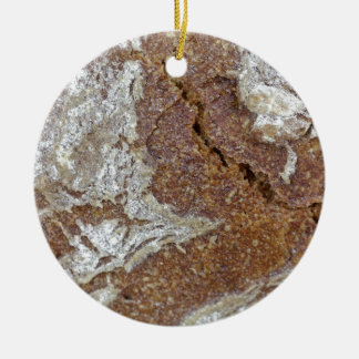 Macro photo of the surface of brown bread from Ger Round Ceramic Ornament
