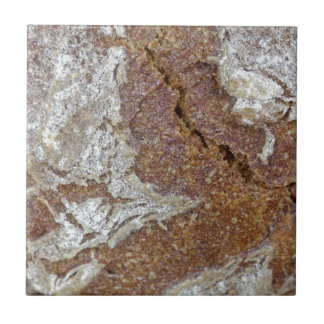Macro photo of the surface of brown bread from Ger Tile