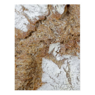Macro photo of the surface of brown bread postcard