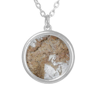Macro photo of the surface of brown bread silver plated necklace