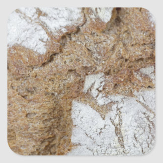 Macro photo of the surface of brown bread square sticker