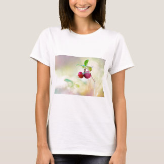 Macro shot of cowberry growing in forest. T-Shirt