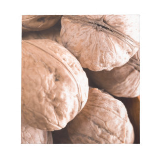 Macro view of a group of old walnuts notepad