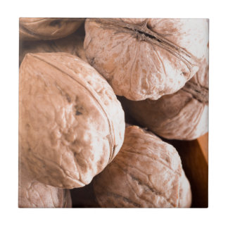 Macro view of a group of old walnuts tile