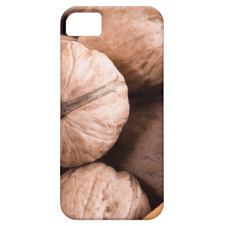 Macro view of a group of walnuts in a wooden box iPhone 5 cases