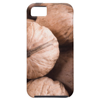 Macro view of a group of walnuts in a wooden box iPhone 5 cover