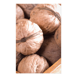 Macro view of a group of walnuts in a wooden box stationery