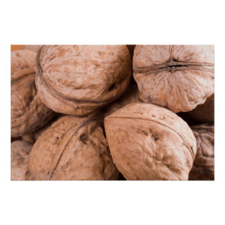 Macro view of a group of walnuts poster