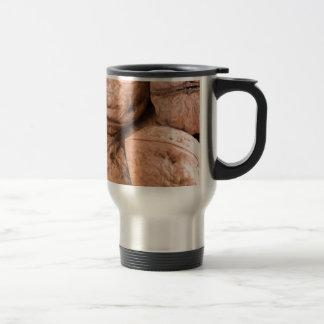 Macro view of a group of walnuts travel mug