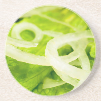 Macro view of the leaves of lettuce and onion ring beverage coasters