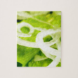 Macro view of the leaves of lettuce and onion ring jigsaw puzzle