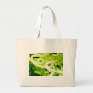 Macro view of the leaves of lettuce and onion ring large tote bag