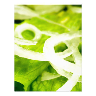 Macro view of the leaves of lettuce and onion ring letterhead