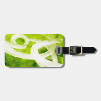 Macro view of the leaves of lettuce and onion ring luggage tag