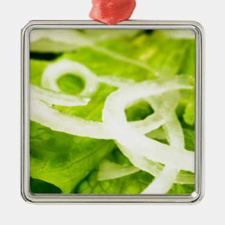 Macro view of the leaves of lettuce and onion ring metal ornament