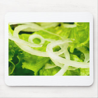 Macro view of the leaves of lettuce and onion ring mouse pad