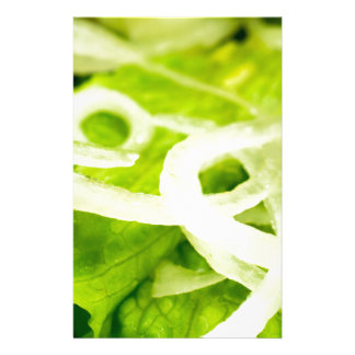 Macro view of the leaves of lettuce and onion ring stationery
