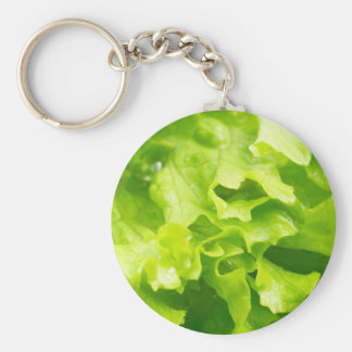 Macro view of the leaves of lettuce in a salad basic round button keychain