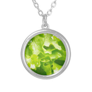 Macro view of the leaves of lettuce in a salad silver plated necklace