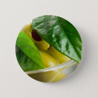 Macro view of the marinated olives with green 2 inch round button