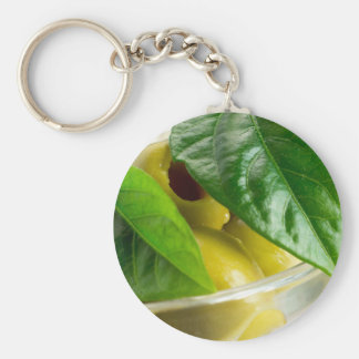 Macro view of the marinated olives with green basic round button keychain