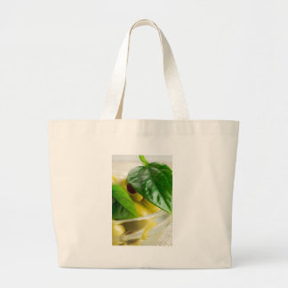 Macro view of the marinated olives with green large tote bag