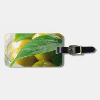 Macro view of the olives with green leaves closeup luggage tag