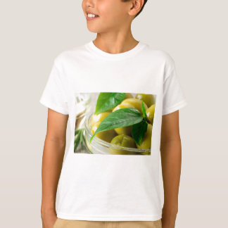 Macro view of the olives with green leaves closeup T-Shirt