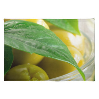 Macro view of the olives with green leaves placemat