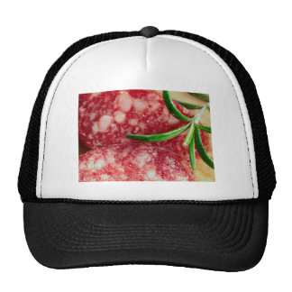 Macro view of the sausage and bacon trucker hat