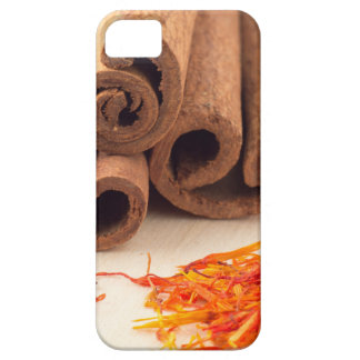 Macro view of the sticks of cinnamon and saffron iPhone 5 covers